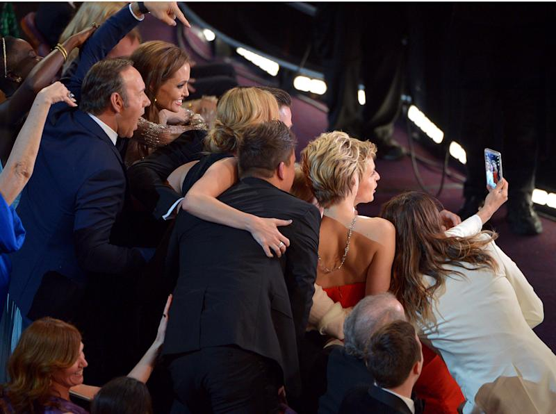 """Kevin Spacey, from left, Angelina Jolie, Julia Roberts, Brad Pitt, Jennifer Lawrence, Ellen Degeneres and Jared Leto join other celebrities for a """"selfie"""" during the Oscars at the Dolby Theatre on Sunday, March 2, 2014, in Los Angeles. (Photo by John Shearer/Invision/AP)"""