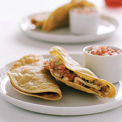"""<div class=""""caption-credit""""> Photo by: James Carrier</div><div class=""""caption-title"""">Crisp Chicken Tacos (Tacos de Pollo)</div><b>Crisp Chicken Tacos (Tacos de Pollo) <br></b>One bite and you won't want to go back to fast-food, especially after you realize how simple these classic crispy tacos are to make. Our version is perked up with a refreshing tomato-cucumber salsa. <br> <b>> <a rel=""""nofollow"""" href=""""http://www.sunset.com/food-wine/kitchen-assistant/easy-mexican-dinner-recipes-00400000044626/page9.html"""" target=""""_blank"""">Get the recipe</a></b>"""