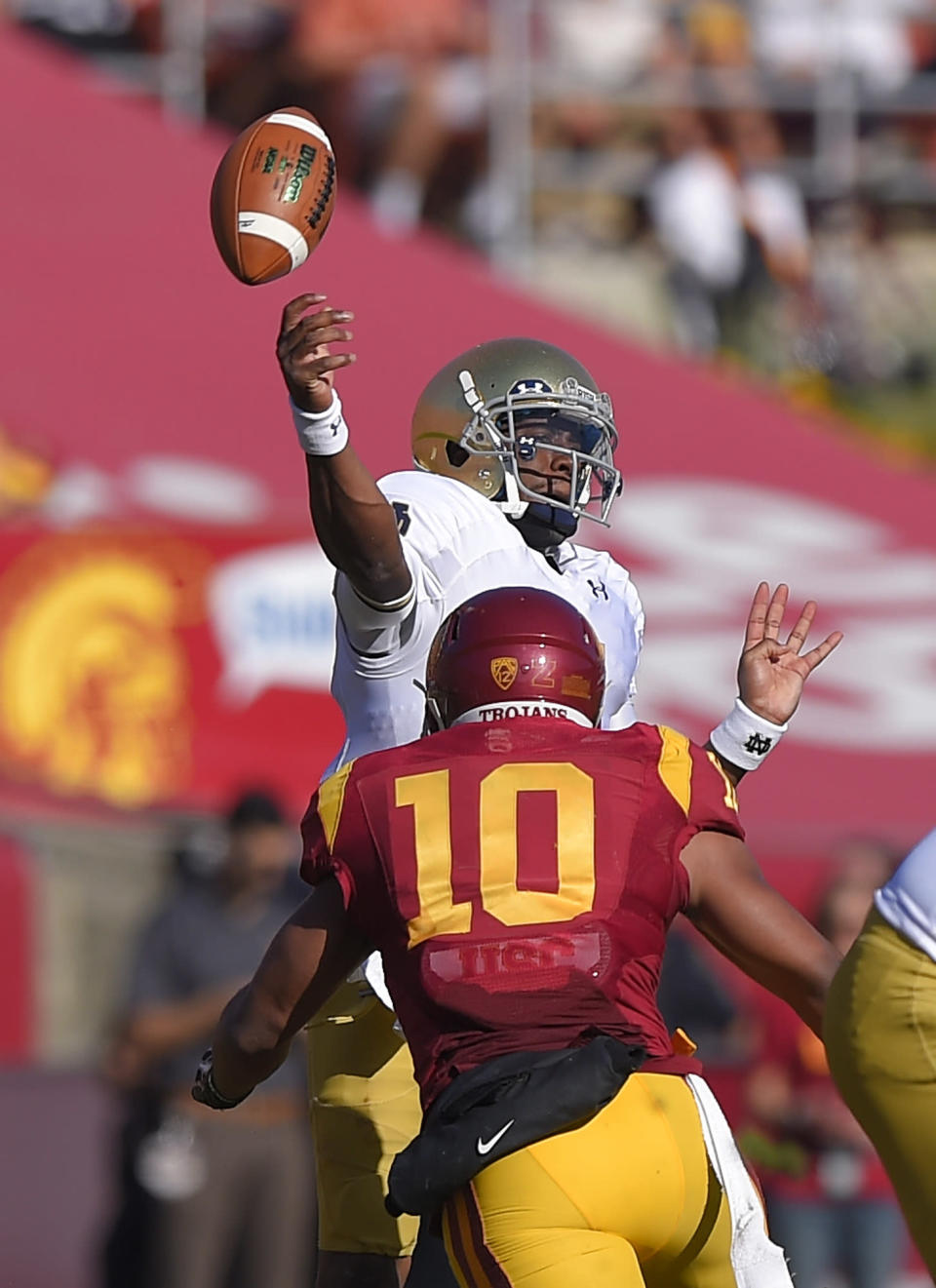 Notre Dame quarterback Everett Golson, top, passes before being hit by Southern California linebacker Hayes Pullard during the first half of an NCAA college football game, Saturday, Nov. 29, 2014, in Los Angeles. (AP Photo/Mark J. Terrill)