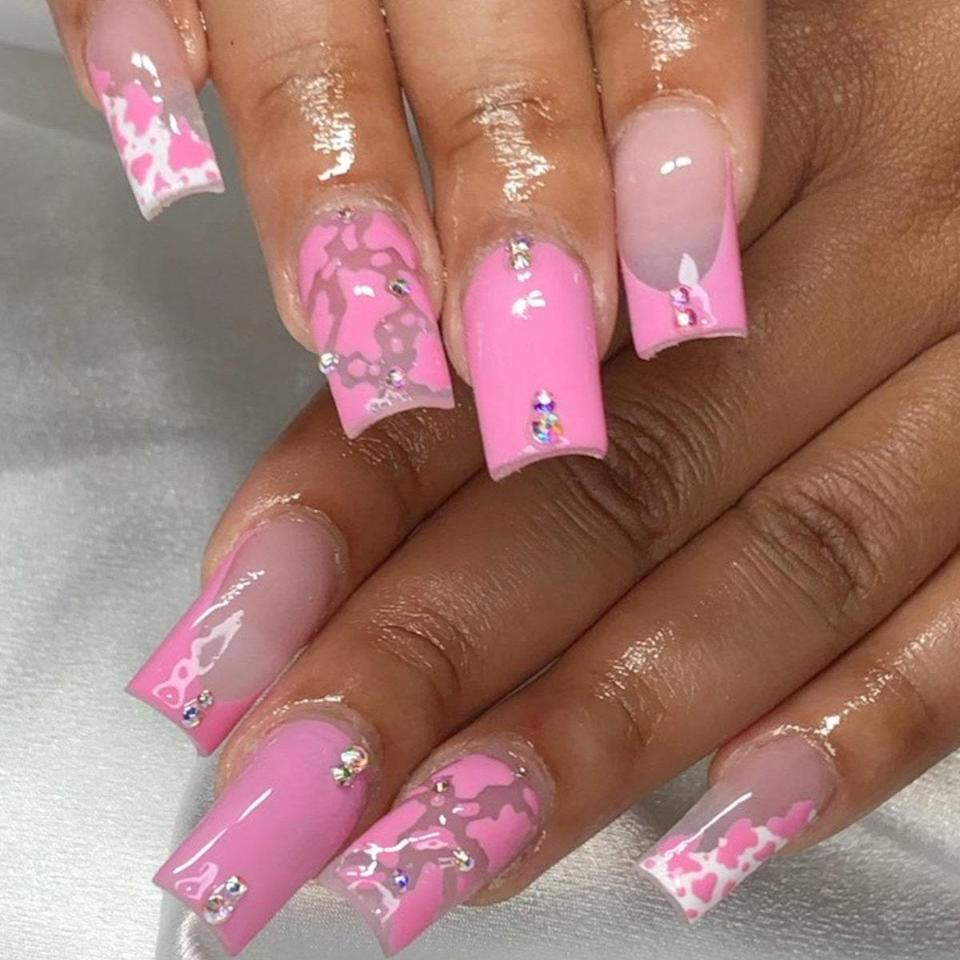 We have a feeling Regina George would approve of these pretty, pink, medium-length nails. Martin incorporated both cow print and a c-curve French manicure tip for this square-shaped set. We love the teeny-tiny gem decals as well.