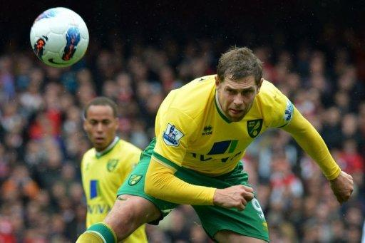 Norwich City striker Grant Holt heads the ball during the Premier League match against Arsenal at The Emirates Stadium