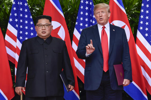 <p>President Donald Trump makes a statement before saying goodbye to North Korea leader Kim Jong Un after their meetings at the Capella resort on Sentosa Island Tuesday, June 12, 2018 in Singapore. (Photo: Susan Walsh, Pool/AP) </p>