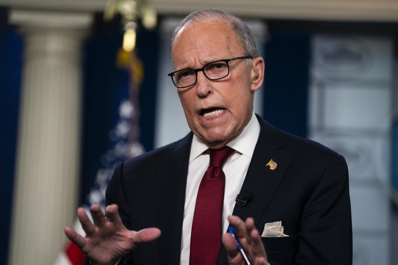 White House chief economic adviser Larry Kudlow talks with reporters about the impact of the Coronavirus on markets in the Brady Press Briefing Room of the White House, Friday, Feb. 28, 2020, in Washington. (AP Photo/Evan Vucci)