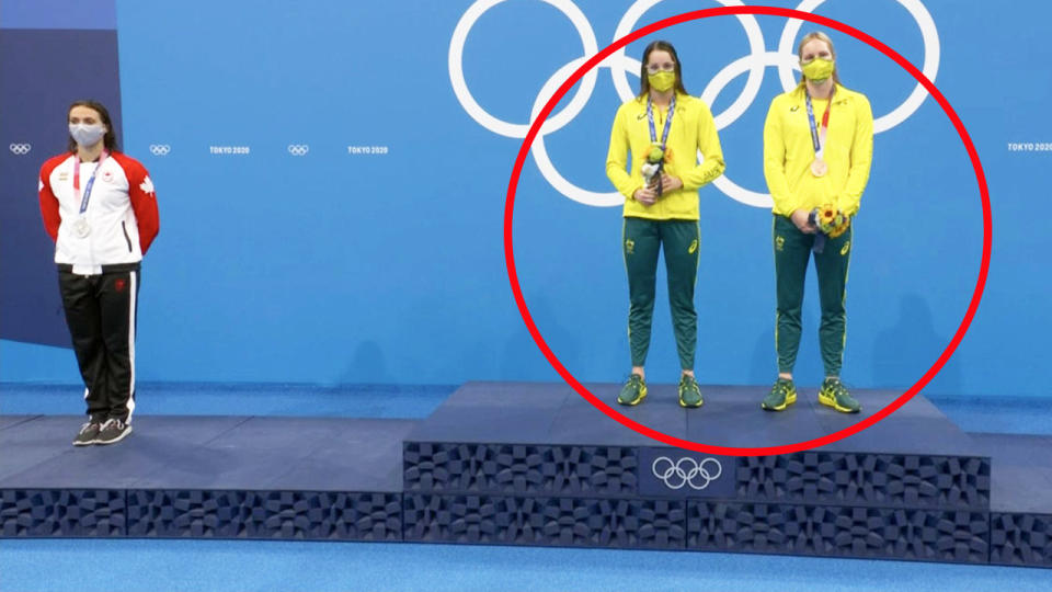 Kaylee McKeown, pictured here after she invited Emily Seebohm onto the top podium for the national anthem.