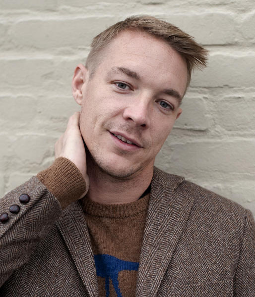 DJ and music producer Diplo poses for a portrait at the Mad Decent Studios on Thursday, Feb. 7, 2013 in Los Angeles. (Photo by Dan Steinberg/Invision/AP)