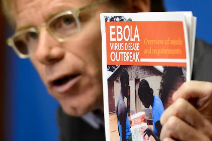 WHO Assistant Director General Bruce Aylward holds a report about Ebola during a press conference on September 16, 2014, in Geneva, Switzerland (AFP Photo/Fabrice Coffrini)