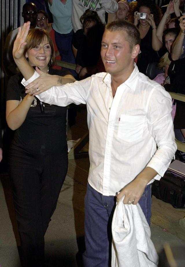 Channel 4's Big Brother hostess Davina McCall (left), escorts Brian from the Big Brother house, to claim the 70,000 prize. (Photo by John Stillwell - PA Images/PA Images via Getty Images)