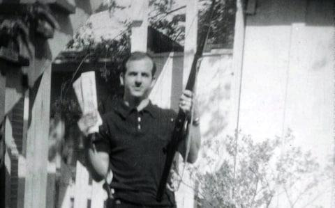 <span>Lee Harvey Oswald, accused of assassinating former U.S. President John F. Kennedy, is pictured holding a rifle and communist flag in this undated Dallas Police Department Archive image</span> <span>Credit: Reuters </span>