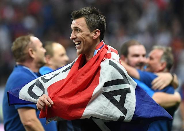 National hero: Mario Mandzukic's goal against England took Croatia into the World Cup final for the first time (AFP Photo/YURI CORTEZ)