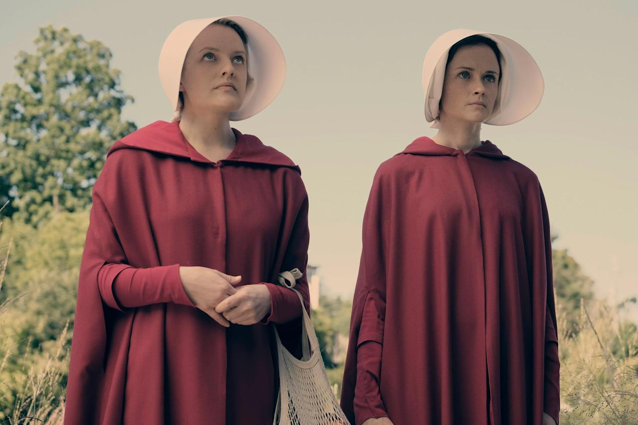 """<p>Based on Margaret Atwood 1985 novel of the same name, this dystopian drama stars <a class=""""sugar-inline-link ga-track"""" title=""""Latest photos and news for Elisabeth Moss"""" href=""""https://www.popsugar.com/Elisabeth-Moss"""" target=""""_blank"""" data-ga-category=""""Related"""" data-ga-label=""""https://www.popsugar.com/Elisabeth-Moss"""" data-ga-action=""""&lt;-related-&gt; Links"""">Elisabeth Moss</a> as June/Offred, a woman forced into child-bearing slavery after the US is taken over by a totalitarian government following a second civil war. Though separated from her husband and daughter and made a Handmaid to Commander Fred Waterford, June never gives up hope of escape - and, eventually, retribution. </p> <p><a href=""""http://www.hulu.com/series/the-handmaids-tale-565d8976-9d26-4e63-866c-40f8a137ce5f"""" target=""""_blank"""" class=""""ga-track"""" data-ga-category=""""Related"""" data-ga-label=""""http://www.hulu.com/series/the-handmaids-tale-565d8976-9d26-4e63-866c-40f8a137ce5f"""" data-ga-action=""""In-Line Links"""">Watch<strong> The Handmaid's Tale </strong>on Hulu</a>. </p>"""
