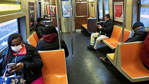 PHOTO: Subway passengers space out their seating during a during rush hour on a subway, March 17, 2020 in New York City. The subway is normally crowded but many people are staying home out of concern for the spread of coronavirus. (Mark Lennihan/AP)