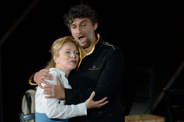 "Jonas Kaufmann (L) as Don José and Inva Mula (R) as Micaela, perform during the rehearsal of the opera ""Carmen"""