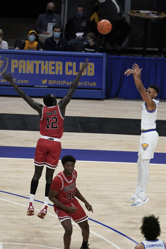 Pittsburgh's Au'diese Toney, top right, hits a three-point basket over Northern Illinois' Zool Kueth (12) during the first half of an NCAA college basketball game, Saturday, Dec. 5, 2020, in Pittsburgh. (AP Photo/Keith Srakocic)