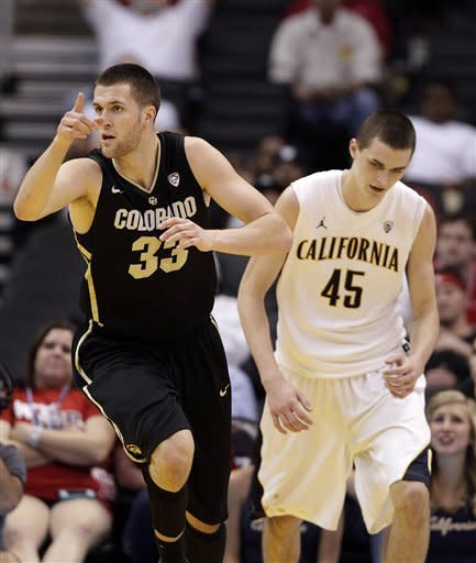 Colorado's Austin Dufault, left, makes his way past California's David Kravish after making a basket during the first half of an NCAA college basketball game in the semifinals of the Pac-12 conference championship in Los Angeles, Friday, March 9, 2012. (AP Photo/Jae C. Hong)