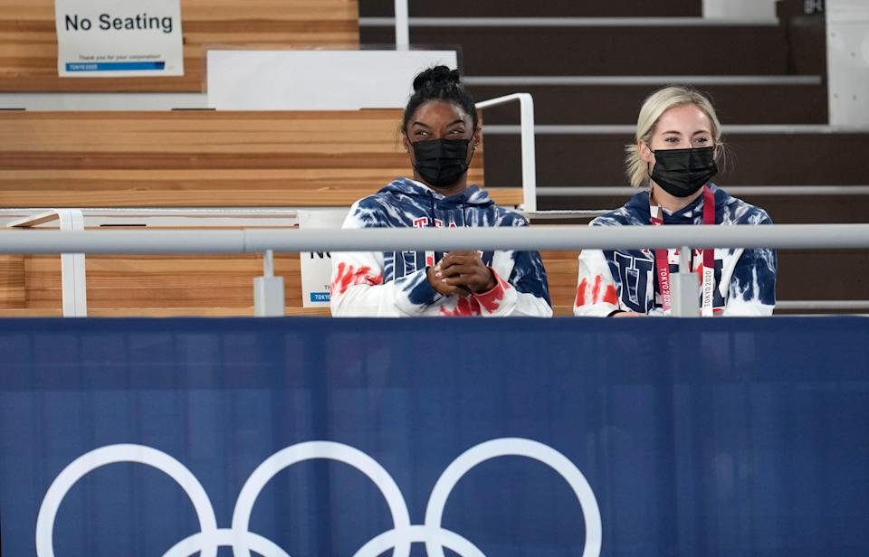 Simone Biles, left, and MyKayla Skinner watch the men's all-around final at the Tokyo Olympics.
