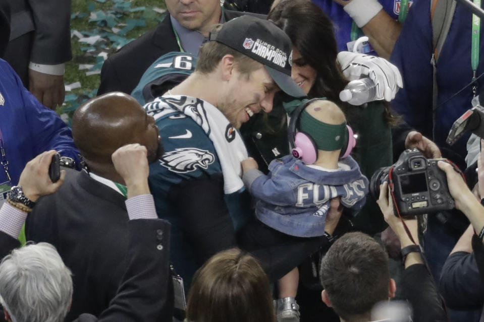 Philadelphia Eagles quarterback Nick Foles celebrates with his daughter, Lily, and wife, Tori, after Super Bowl 52 on Sunday. The Eagles beat the New England Patriots, 41-33. (AP)