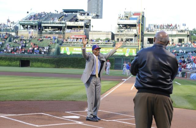 CHICAGO, IL - AUGUST 13: Hall of Famer Ernie Banks is recognized before the game between the Chicago Cubs and the Cincinnati Reds for receiving the Presidential Medal of Freedom on August 13, 2013 at Wrigley Field in Chicago, Illinois. (Photo by David Banks/Getty Images)