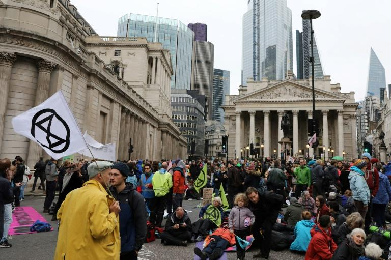 Activists also protested outside of the Bank of England in central London to protest the financing of the fossil fuel industry during the eighth day of demonstrations by the climate change action group Extinction Rebellion