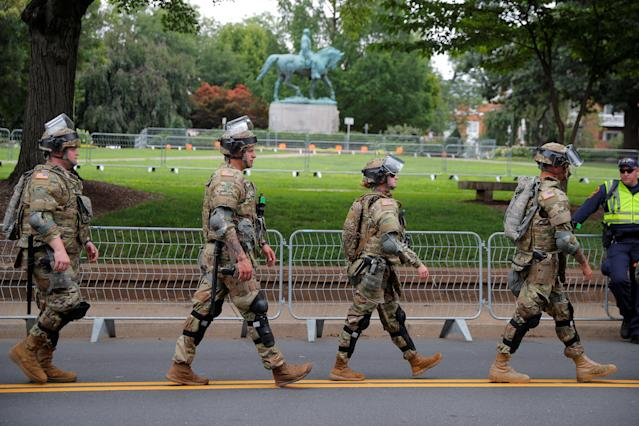 "<p>Law enforcement officers patrol past the statue of Civil War Confederate General Robert E. Lee, ahead of the one-year anniversary of 2017 Charlottesville ""Unite the Right"" protests, in Charlottesville, Va., Aug. 11, 2018. (Photo: Brian Snyder/Reuters) </p>"