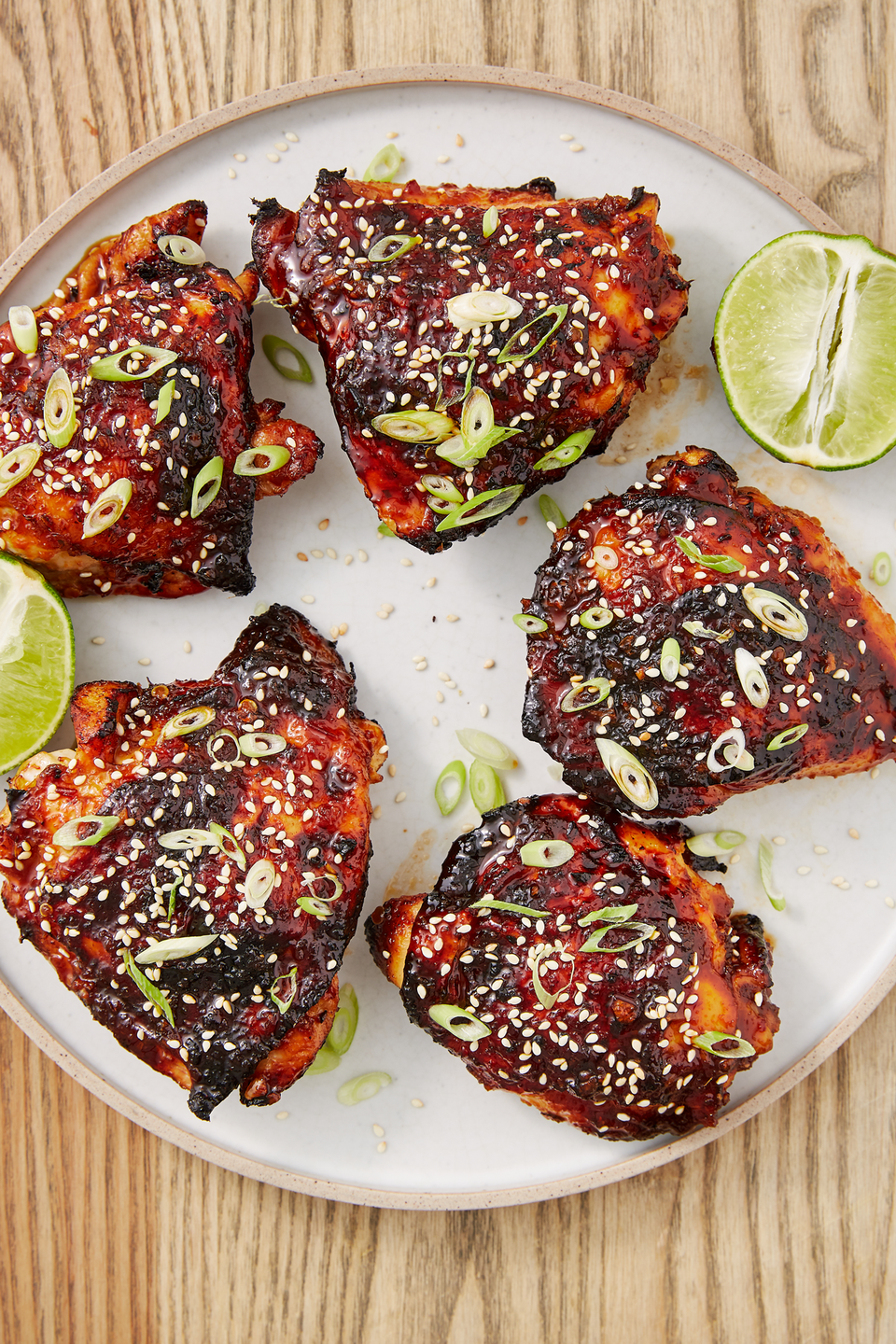 "<p>You'll lose your mind over the sticky glaze. </p><p>Get the recipe from <a href=""https://www.delish.com/cooking/recipe-ideas/a28438728/air-fryer-chicken-thighs-recipe/"" rel=""nofollow noopener"" target=""_blank"" data-ylk=""slk:Delish"" class=""link rapid-noclick-resp"">Delish</a>.</p>"