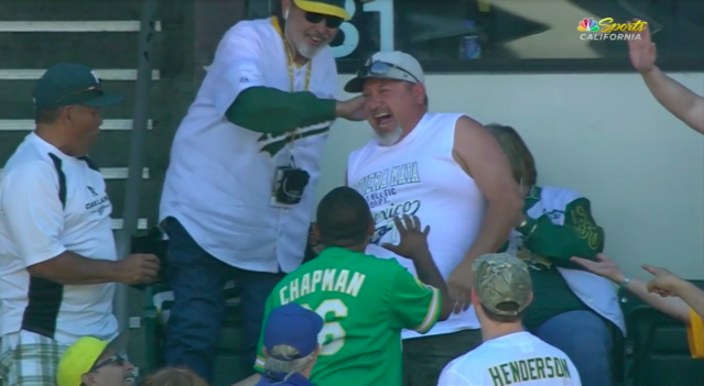 An Athletics fan grabbed two foul balls on two consecutive pitches. (Screenshot via MLB.com)