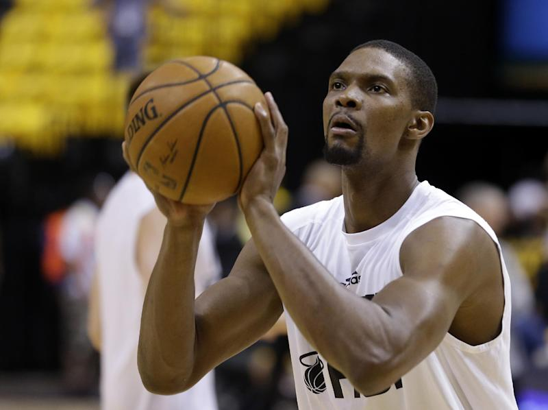 Miami Heat center Chris Bosh shoots during warm-ups before Game 5 of the NBA basketball Eastern Conference finals against the Indiana Pacers in Indianapolis, Wednesday, May 28, 2014