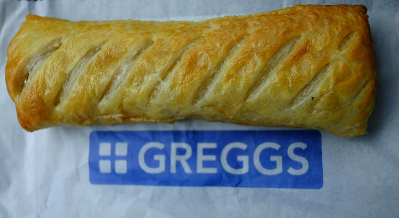 A sausage roll is seen on top of a bag at a Greggs bakery in Manchester, Britain March 1, 2016. Greggs plans to close three bakeries and cut up to 355 jobs as part of a 100-million-pound ($140 million) restructuring programme, the British baker announced on Tuesday. REUTERS/Phil Noble