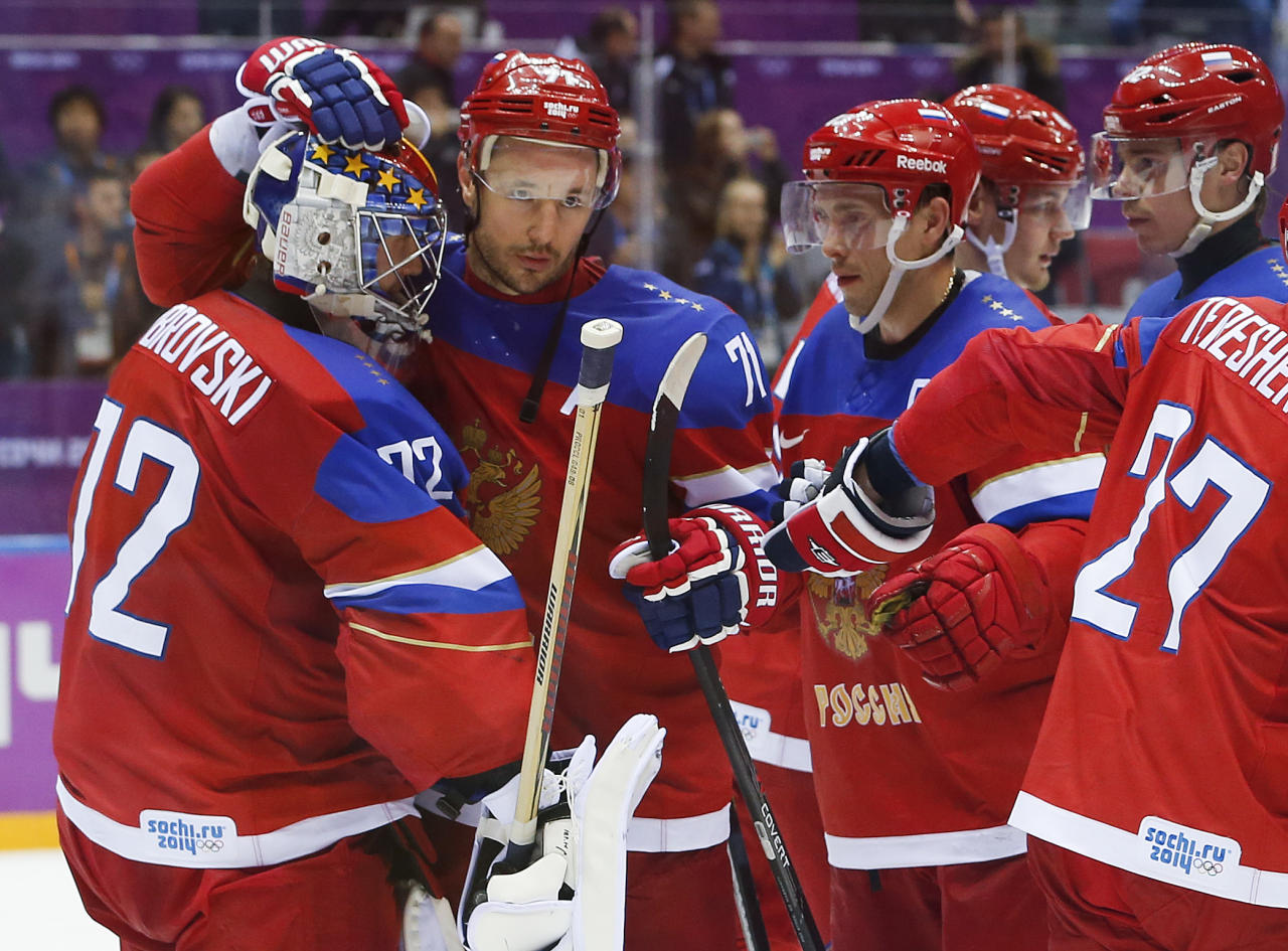 Russia goaltender Sergei Bobrovski is congratulated by teammates after shutting out Norway 4-0 in a men's ice hockey game at the 2014 Winter Olympics, Tuesday, Feb. 18, 2014, in Sochi, Russia. Russia advanced to the quarterfinals. (AP Photo/Mark Humphrey)