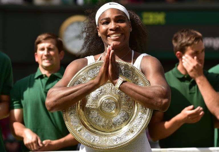 Serena Williams celebrates with the Venus Rosewater Dish, after her women's singles final victory over Garbine Muguruza at the Wimbledon Championships in southwest London, on July 11, 2015