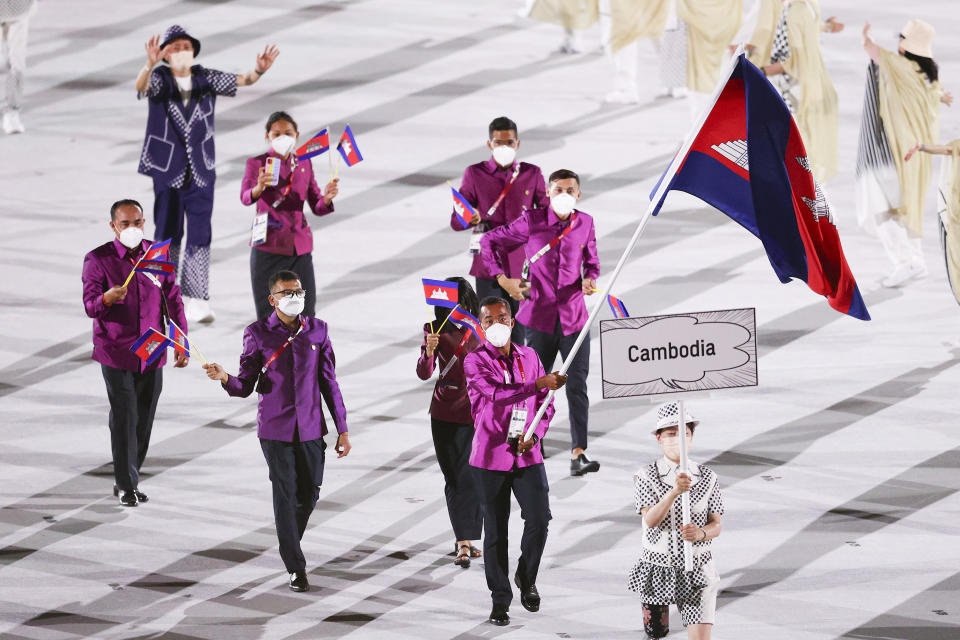 <p>TOKYO, JAPAN - JULY 23: Flag bearers Bunpichmorakat Kheun and Sokong Pen of Team Cambodia lead their team during the Opening Ceremony of the Tokyo 2020 Olympic Games at Olympic Stadium on July 23, 2021 in Tokyo, Japan. (Photo by Patrick Smith/Getty Images)</p>