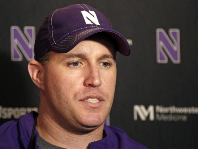 """FILE - In this April 1, 2014, file photo, Northwestern head football coach Pat Fitzgerald speaks at a news conference after his football team participated in an NCAA college spring football practice in Evanston, Ill. Fitzgerald sided with his university against the formation of a players union in his first public comments Saturday, April 1, repeating what he already told his team: """"I believe it's in their best interests to vote no."""" (AP Photo/M. Spencer Green, File)"""