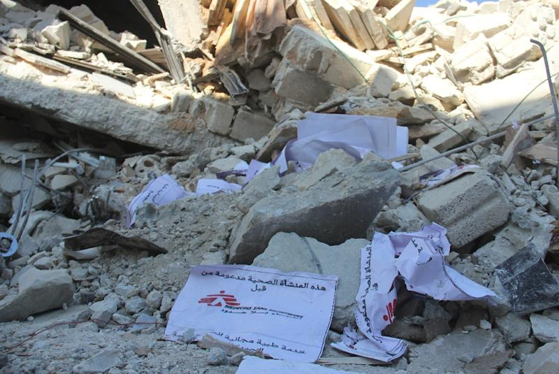 Signs from Doctors Without Borders (MSF) lie amidst debris after a hospital supported by MSF was hit by suspected Russian air strikes near Maaret al-Numan, in Syria's northern province of Idlib, on February 15, 2016 (AFP Photo/Omar haj kadour)