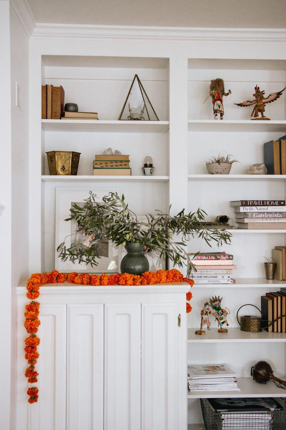 "<p>Marigolds bloom into the fall, which is why Alicia at <a href=""https://cheetahisthenewblack.com/living/baby/diy-marigold-garland/"" rel=""nofollow noopener"" target=""_blank"" data-ylk=""slk:Cheetah is the New Black"" class=""link rapid-noclick-resp"">Cheetah is the New Black</a> blog used them for this bright and festive garland. Simply stitch together some flowers with a needle and thread, then lay or hang the finished product wherever you please.</p><p><a class=""link rapid-noclick-resp"" href=""https://go.redirectingat.com?id=74968X1596630&url=https%3A%2F%2Fwww.michaels.com%2Floops-and-threads-sewing-kit%2F10340631.html&sref=https%3A%2F%2Fwww.delish.com%2Fholiday-recipes%2Fthanksgiving%2Fg33808794%2Fthanksgiving-decorations%2F"" rel=""nofollow noopener"" target=""_blank"" data-ylk=""slk:BUY NOW"">BUY NOW</a> <strong><em>Sewing kit, $4.29</em></strong></p>"