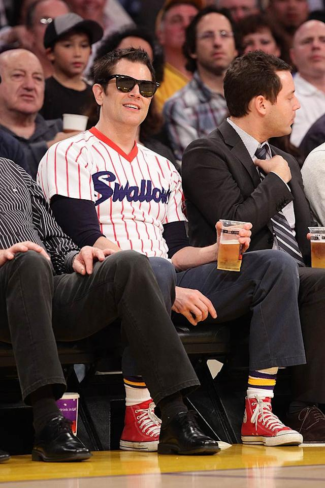 """Rocking a bright red pair of Converse Chucks, """"Jackass"""" star Johnny Knoxville kicked back with a cold beer while sitting courtside at the Staples Center in downtown Los Angeles Tuesday night, where the Lakers trounced the Utah Jazz 120-91. Noel Vasquez/<a href=""""http://www.gettyimages.com/"""" target=""""new"""">GettyImages.com</a> - January 25, 2011"""