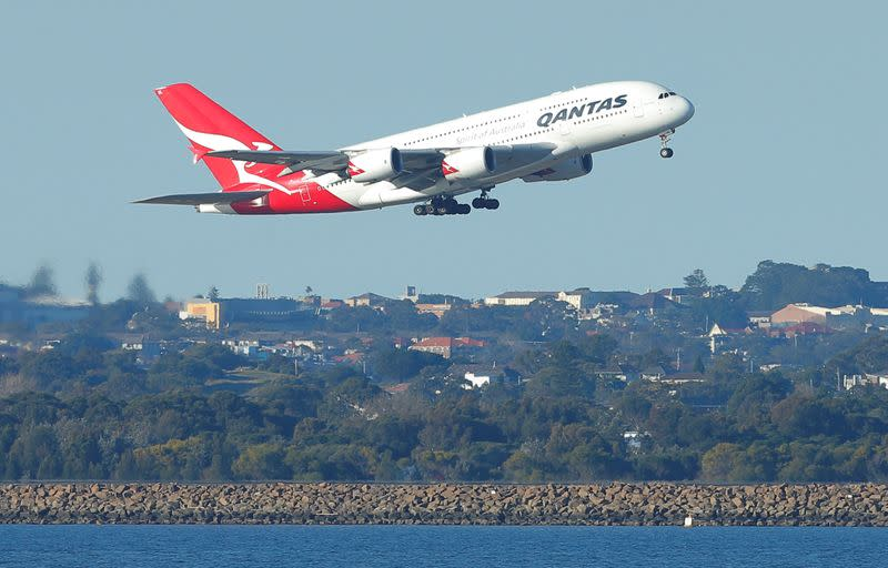 FILE PHOTO: Qantas flight QF1, an Airbus A380 aircraft, takes off from Sydney International Airport en route to Dubai, above Botany Bay