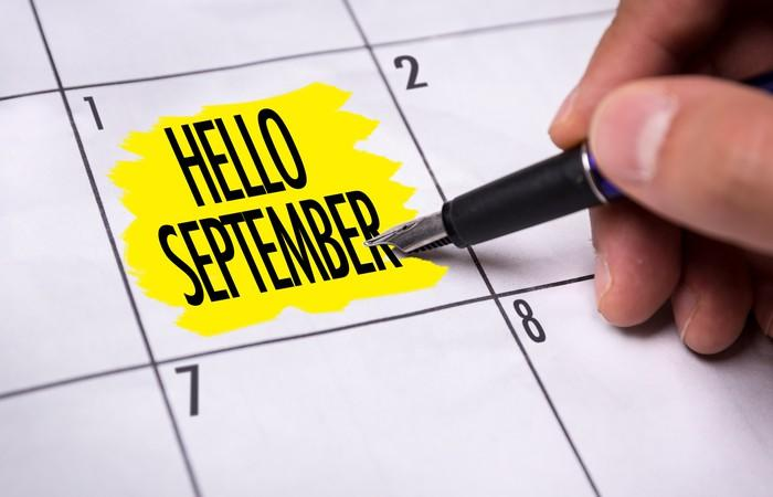 """Calendar with """"Hello September"""" highlighted in yellow on the square for day 1"""