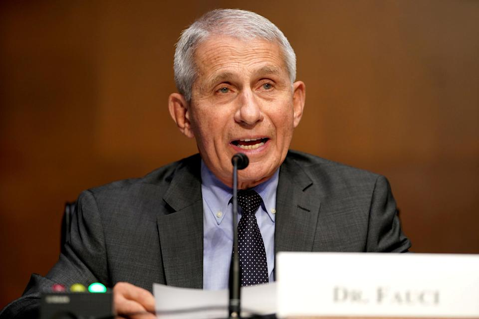 <p>Dr Fauci says early research indicates the Covid vaccines are effective against the Indian variants</p> (REUTERS)