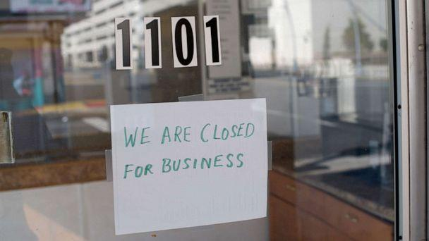 PHOTO: A sign at a motel lobby states 'WE ARE CLOSED FOR BUSINESS' during the coronavirus pandemic on May 7, 2020 in Atlantic City, New Jersey. (Mark Makela/Getty Images, FILE)
