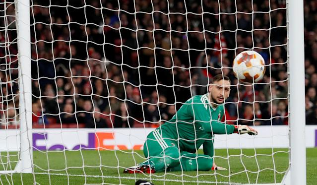 Soccer Football - Europa League Round of 16 Second Leg - Arsenal vs AC Milan - Emirates Stadium, London, Britain - March 15, 2018 AC Milan's Gianluigi Donnarumma looks on dejected after Arsenal's Granit Xhaka scores their second goal REUTERS/David Klein