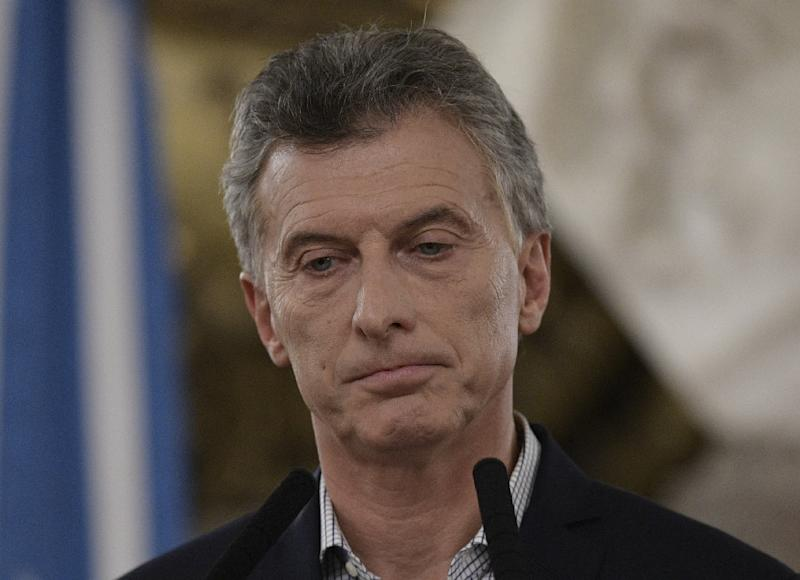 Argentina's President Mauricio Macri gestures during a press conference at the Casa Rosada in Buenos Aires on February 16, 2017