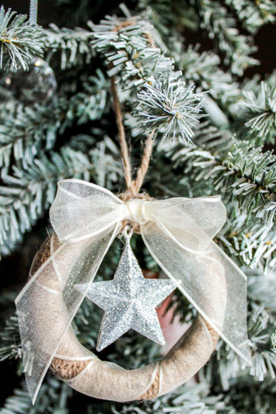 """<p>Mismatched lids missing their mates can become a new trash-to-treasure craft that will look great on your tree. How adorable is this decoration? </p><p><em><a href=""""http://domesticallyblissful.com/sparkling-star-mason-jar-lid-ornament/"""" rel=""""nofollow noopener"""" target=""""_blank"""" data-ylk=""""slk:Get the tutorial at Domestically Blissful »"""" class=""""link rapid-noclick-resp"""">Get the tutorial at Domestically Blissful »</a> </em></p><p><strong>RELATED:</strong> <a href=""""https://www.goodhousekeeping.com/holidays/christmas-ideas/g2993/mason-jar-christmas-crafts/"""" rel=""""nofollow noopener"""" target=""""_blank"""" data-ylk=""""slk:Mason Jar Christmas Crafts to Make as Gifts (or Keep for Yourself)"""" class=""""link rapid-noclick-resp"""">Mason Jar Christmas Crafts to Make as Gifts (or Keep for Yourself)</a></p>"""