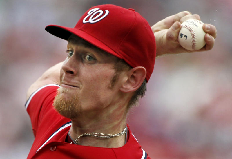 Washington Nationals starting pitcher Stephen Strasburg throws during the second inning of a baseball game with the St. Louis Cardinals at Nationals Park, Sunday, Sept. 2, 2012, in Washington. (AP Photo/Alex Brandon)