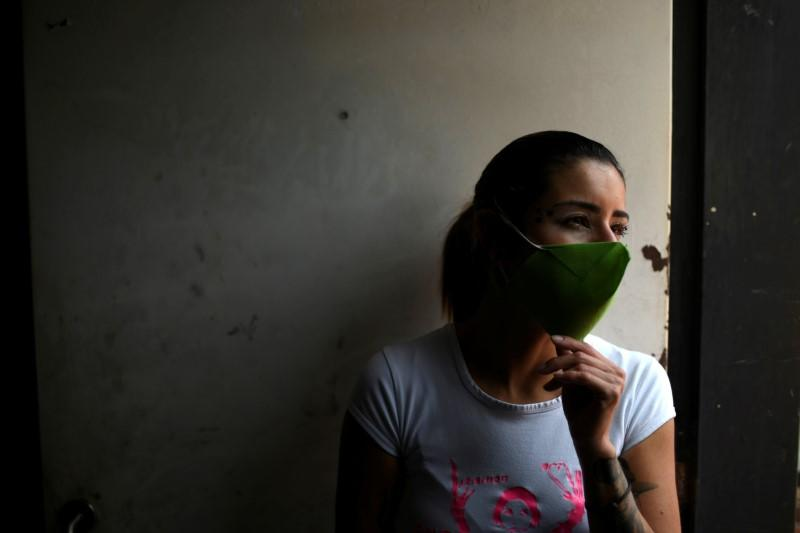 Clothing designer Stalina Svieykowsky models a face mask she made a new business venture with her partner Nelson Jimenez as a reponse to the coronavirus disease (COVID-19), in San Antonio de los Altos