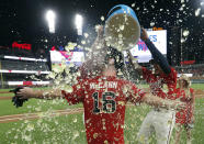Atlanta Braves' Brian McCann (16) is doused by teammates after driving in the winning run with a two-run single during the ninth inning of the team's baseball game against the Philadelphia Phillies on Friday, June 14, 2019, in Atlanta. The Braves won 9-8. (AP Photo/John Bazemore)
