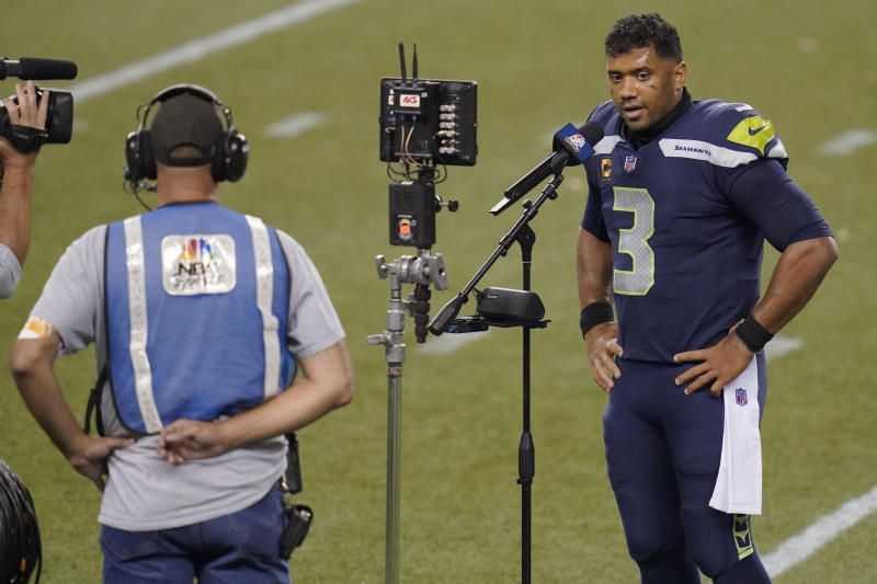 Russell Wilson at the microphone, socially distanced from the camera and interviewer.