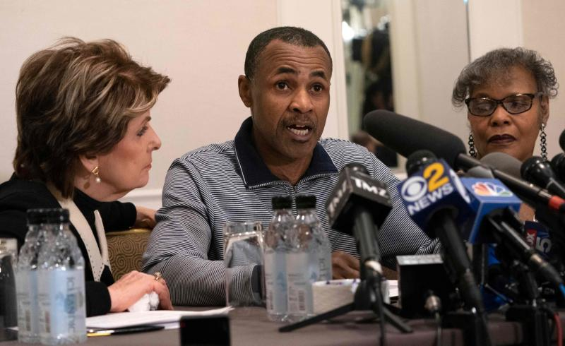 Gary Dennis speaks at a news conference along with attorney Gloria Allred, left, in New York. At right is Dennis' wife Sallie.