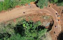 """The dirt roads in the """"San Coca"""" lands can become impassable when heavy rains fall (AFP/Raul ARBOLEDA)"""