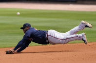 Atlanta Braves first baseman Pablo Sandoval can't reach a ball hit for a single by Tampa Bay Rays' Willy Adames in the fifth inning of a spring training baseball game Sunday, March 21, 2021, in Port Charlotte, Fla. (AP Photo/John Bazemore)