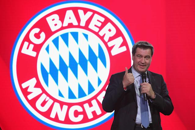 Baverian Prime Minister Markus Soeder gives a speech at the party of Bayern Munich celebrating winning the Bundesliga trophy at the Nockherberg beer garden in Munich, Germany, May 12, 2018. Picture taken May 12, 2018. Alexander Hassenstein/Pool via Reuters