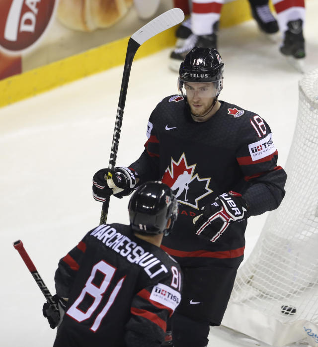Canada's Pierre-Luc Dubois, right, celebrates with Canada's Jonathan Marchessault, left, after scoring his sides first goal during the Ice Hockey World Championships group A match between Canada and Denmark at the Steel Arena in Kosice, Slovakia, Monday, May 20, 2019. (AP Photo/Petr David Josek)